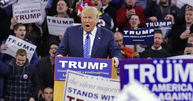 Trump embraces Muslim ban in opening TV ads