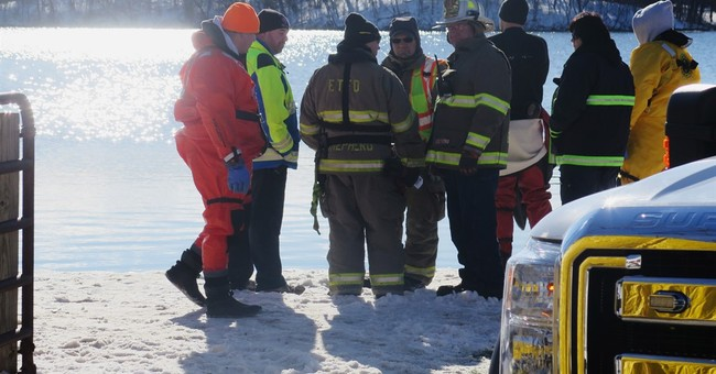 The Latest: Crews suspend Wisconsin lake search for night