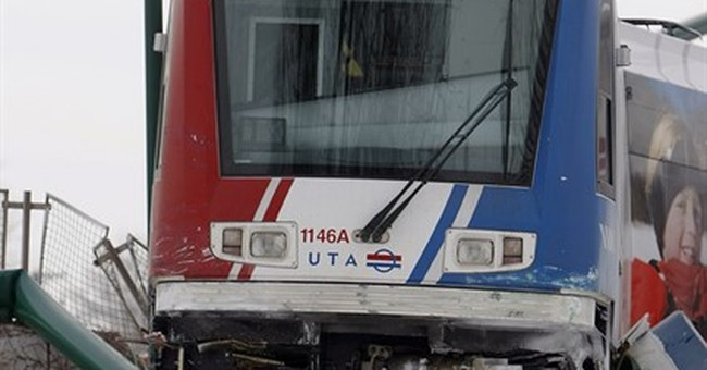 1 dead after car collides with light rail in Salt Lake City