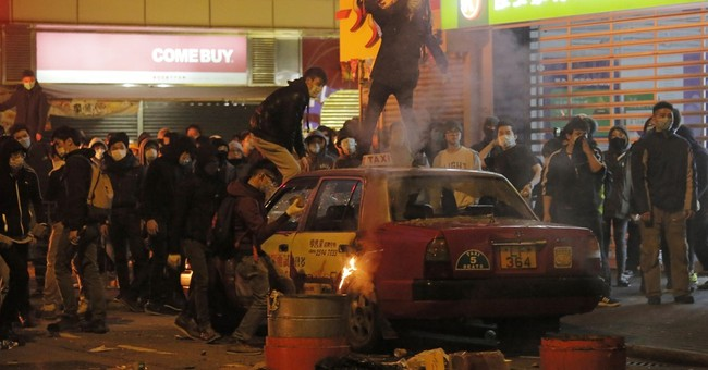 AP Photos: Hong Kong new year celebration marred by violence