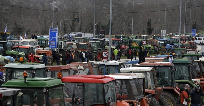 Greek farmers block main highway in protest against reform