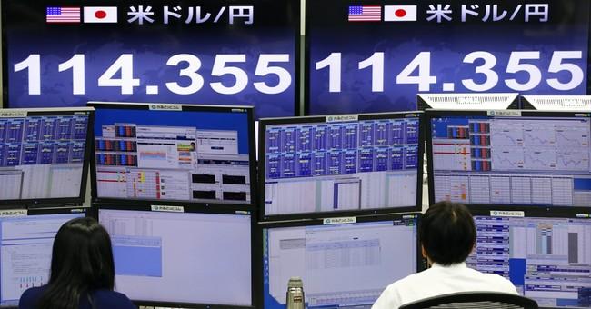 The Latest: European stocks close down amid world volatility