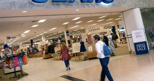After challenging holiday, Sears to speed up store closings