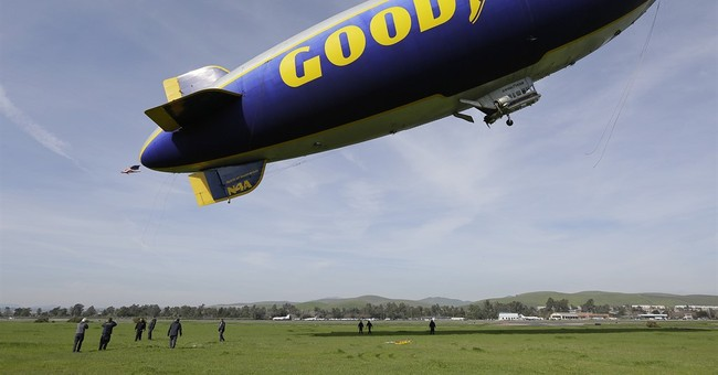 Goodyear reports 4Q loss on hefty charge