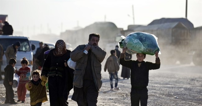 Hoarding in Syria's largest city as government advances