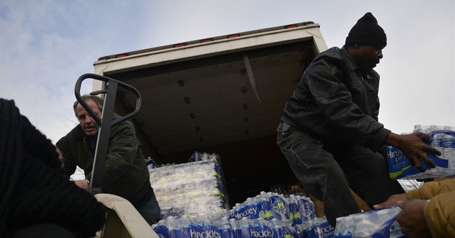 The Latest: Michigan governor proposes $195M more for Flint