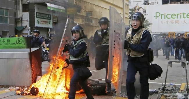 AP Photos: Hong Kong new year celebration marred by violence