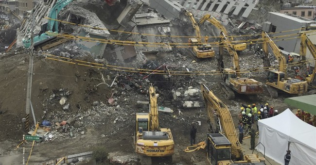 Developers of toppled Taiwan building detained