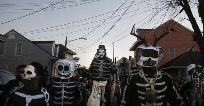 The Latest on Mardi Gras: Cold is relative as parades roll