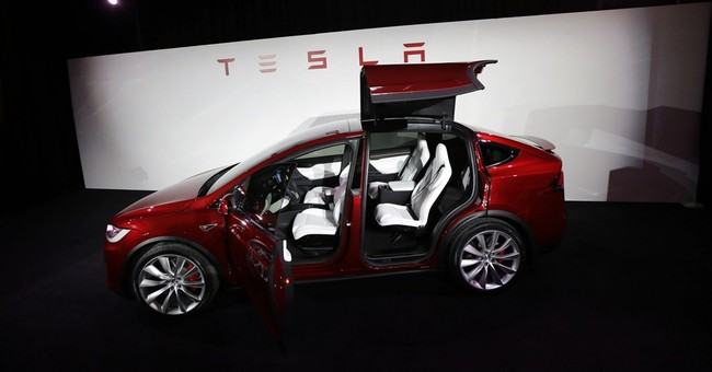 Tesla's 4Q net loss doubles but shares up on outlook