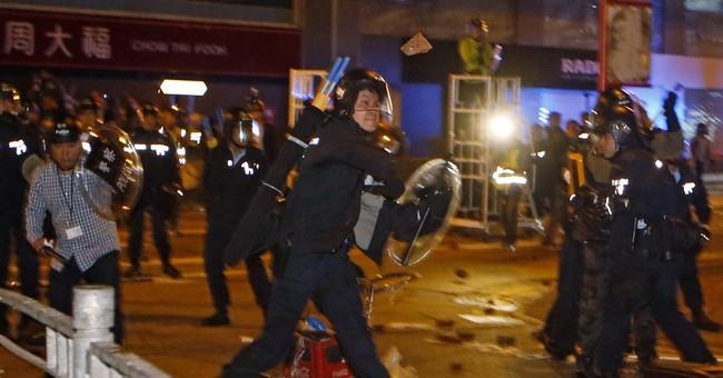Hong Kong student held at airport after violent clashes