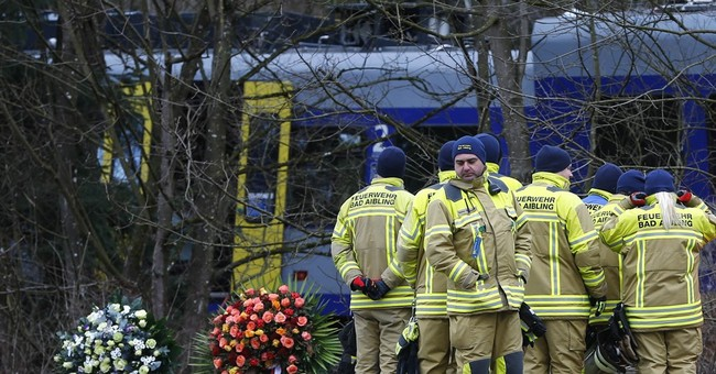 Train wreckage being removed in Germany; answers sought