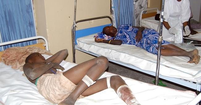 2 female bombers kill 58 in northeast Nigerian refugee camp