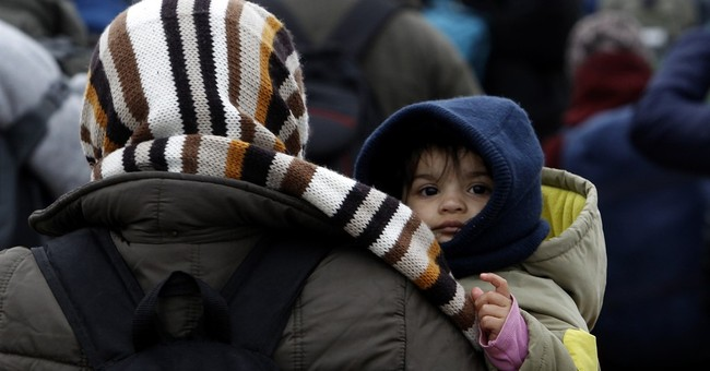 The Latest: EU: Nations not helping refugees in Italy enough