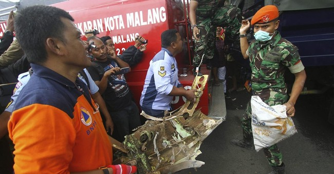 Indonesia air force plane crashes into home; 4 dead