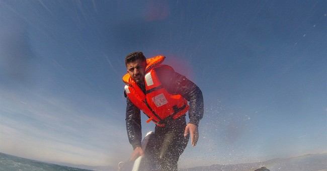 Syrian saved from tip of submerged boat unsure of future