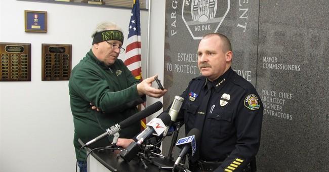 Latest: Police: Fargo officer shot during standoff dies