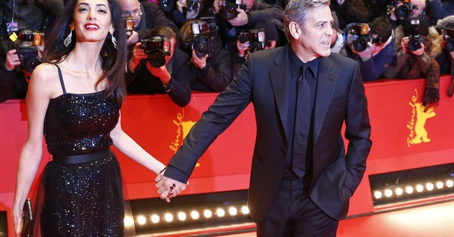 George Clooney hopes to meet Merkel to discuss refugees