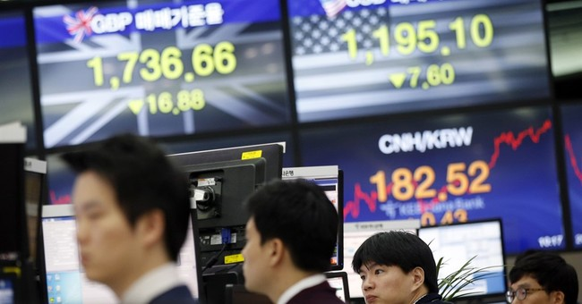 The Latest: US stocks join the global market slump