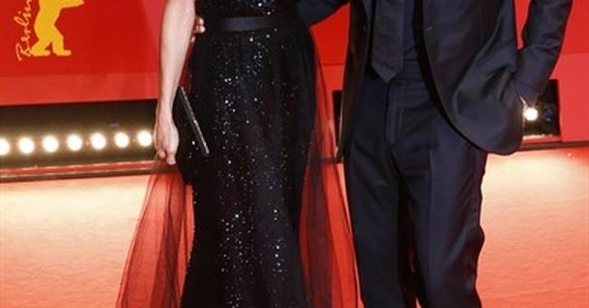George Clooney hopes to meet Merkel to discuss refugees