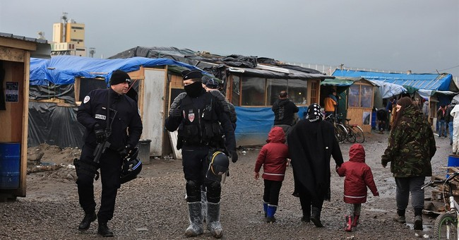 The Latest: Official: Half of Calais camp to be evacuated