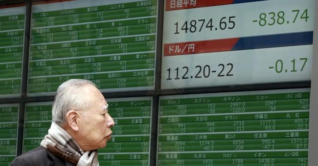 The Latest: European markets close higher after tough week