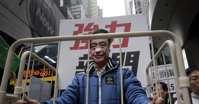 UK: Hong Kong bookseller 'removed' in breach of China treaty