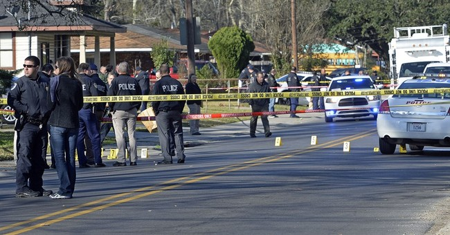 """The Latest: DA says officers """"totally justified"""" in shootout"""