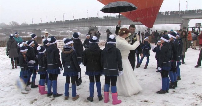 50 Latvian couples get hitched in midair, literally