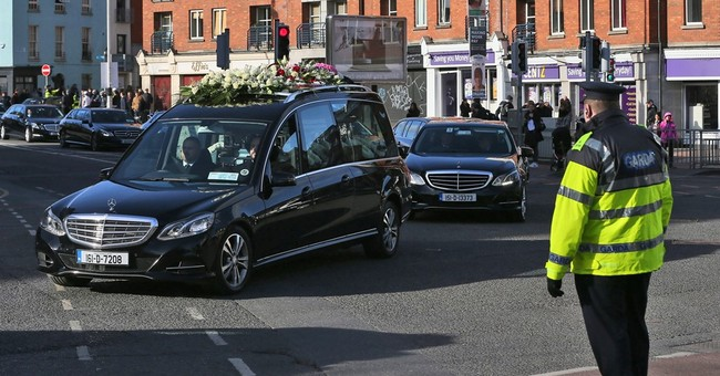 Police protect Dublin funeral of gang figure slain in feud