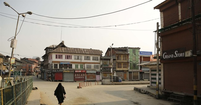 Curfew imposed in Indian Kashmir after 2 killed in protests