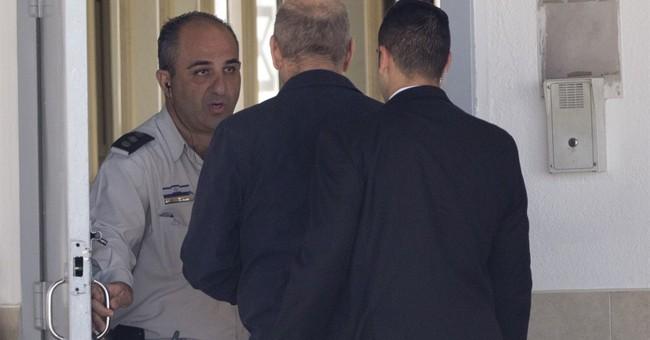 Proclaiming innocence, ex-Israeli PM goes to prison