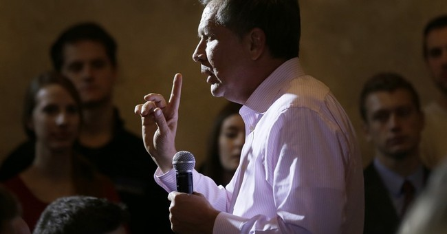 Kasich campaigns in Michigan, while rivals fight in South