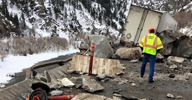 The Latest: Rock slide to keep highway mostly shut for weeks