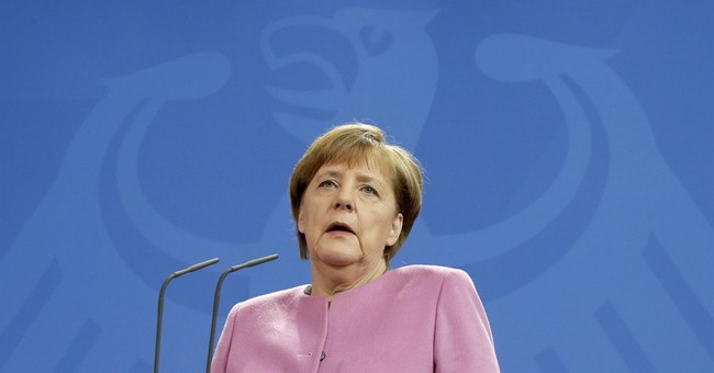 Merkel vows to keep seeking common ground on migrants