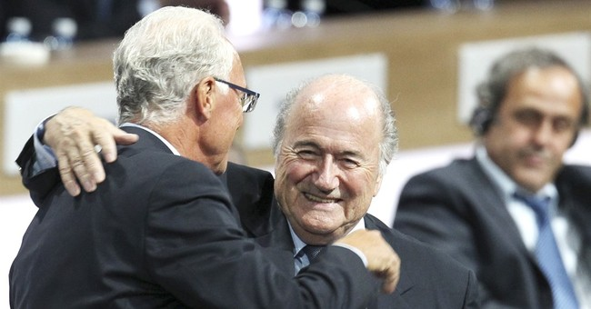 Franz Beckenbauer fined, warned by FIFA ethics judges