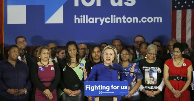 Clinton stresses Obama ties, says she'll build on 'progress'