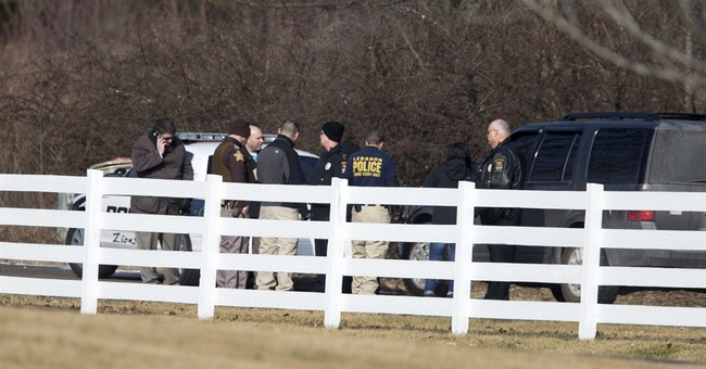 Latest: College president says school saddened over shooting