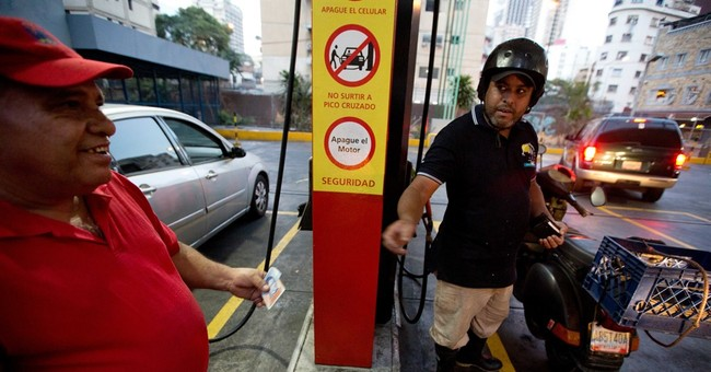 Economically struggling Venezuela hikes gas prices, devalues