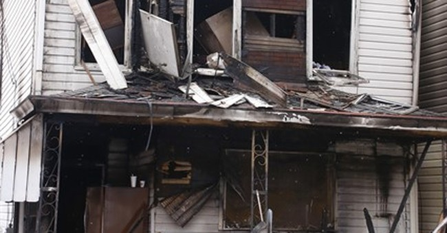 Woman charged with arson in deadly boarding house fire
