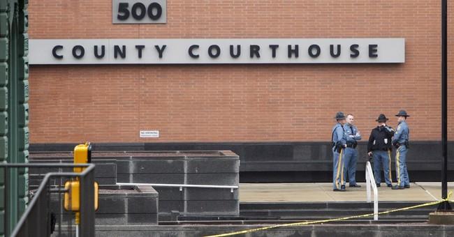 Court gunman's son, daughter sentenced to life in prison