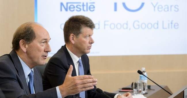 Nestle profit dips due to strong franc, deal-making