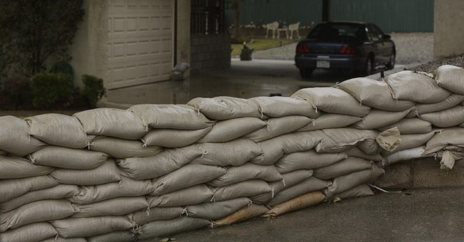 The Latest: 10 mobile homes evacuated because of mudslide