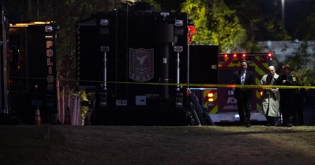 Police: Man who held 12 inside motel room stabs himself