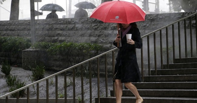The Latest: El Nino-driven storm sets rainfall records