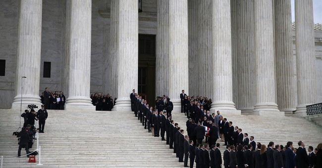 The Latest: Mourners pay respects to late Justice Scalia