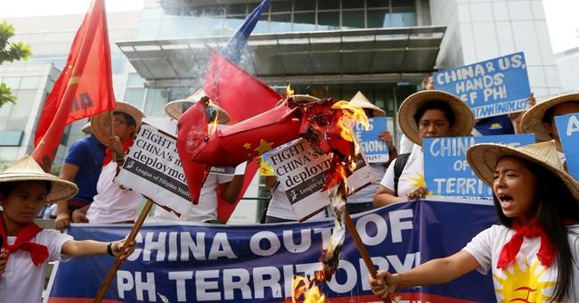 China accuses US of militarizing South China Sea