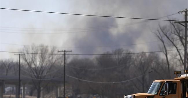 Firefighters douse hotspots at site of 'fire tornado' blaze