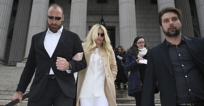 Kesha loses bid to be freed from contract with top producer