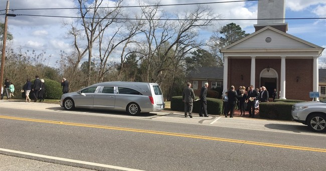 The Latest: Harper Lee laid to rest at private funeral